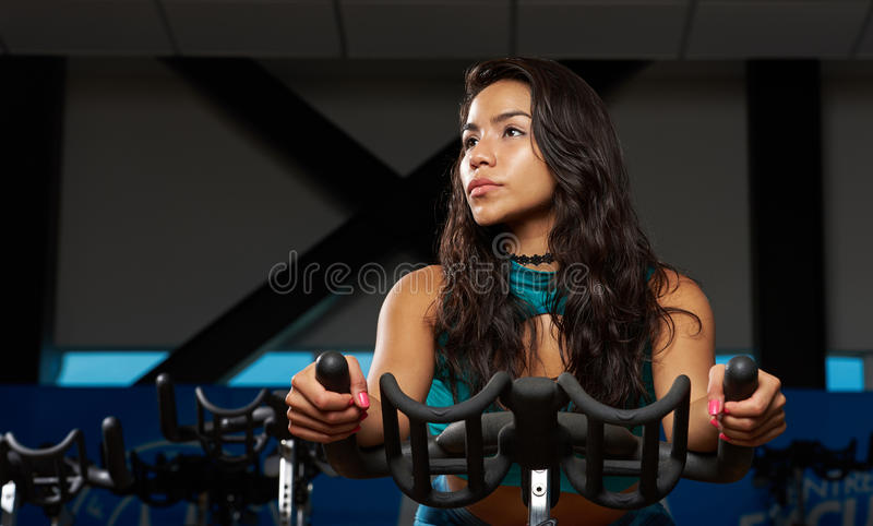 自行车的西班牙女孩 库存图片