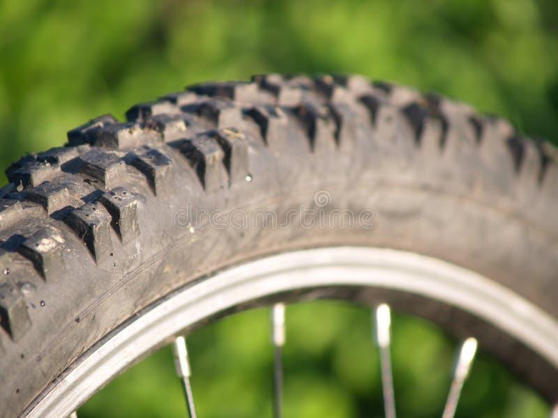 自行车轮胎踩 免版税库存照片