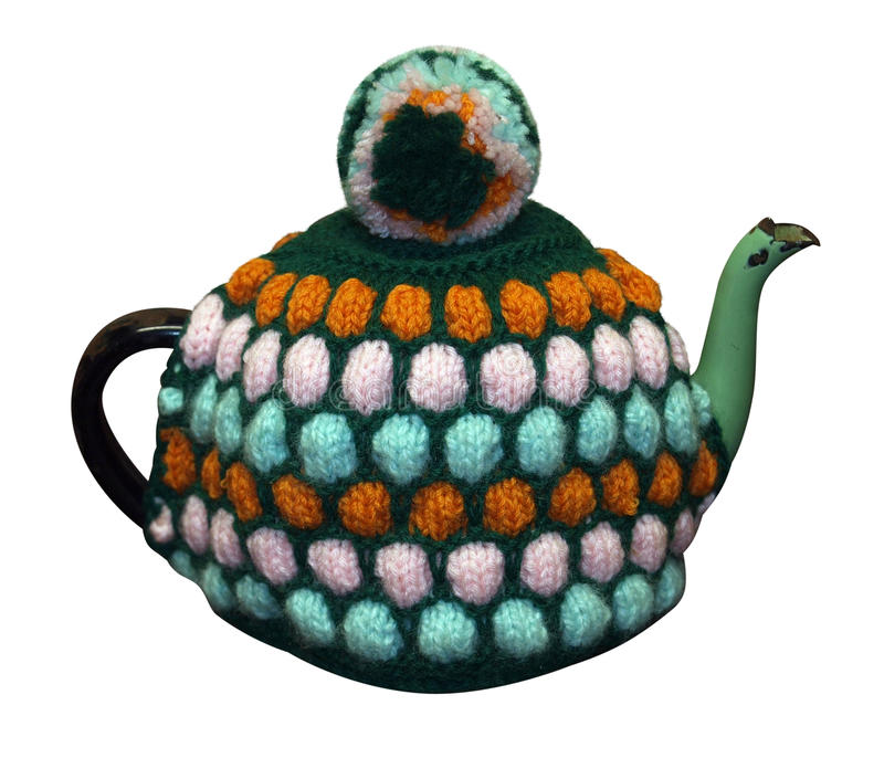 舒适被编织的茶壶 免版税库存照片
