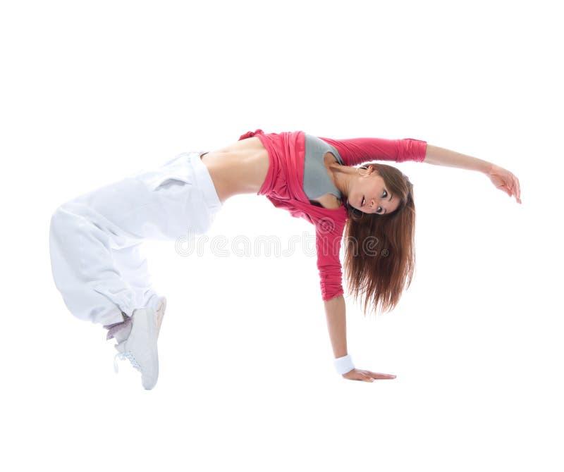 年轻舞蹈家女孩锻炼节律唱诵的音乐样式姿势 图库摄影