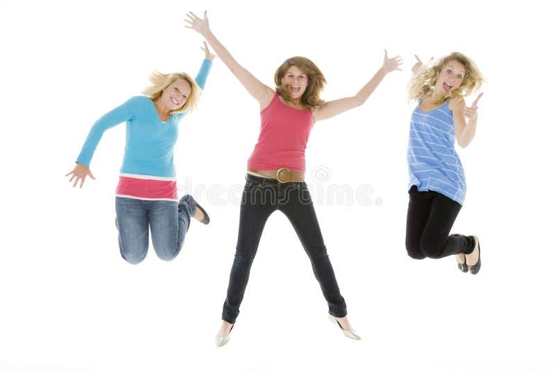 航空女孩跳少年 库存图片
