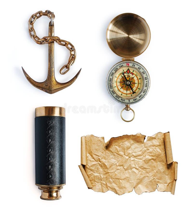船锚、望远镜、指南针和地图或者羊皮纸 免版税图库摄影