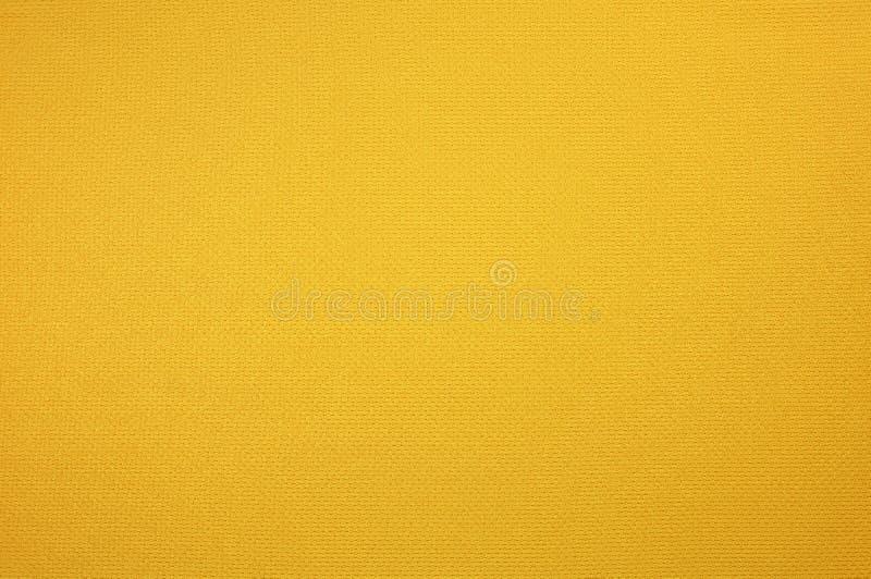 黄色体育球衣衣物纹理 库存图片