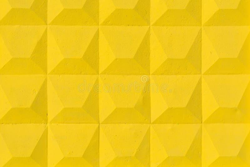 黄色具体篱芭的安心表面的纹理 免版税库存图片