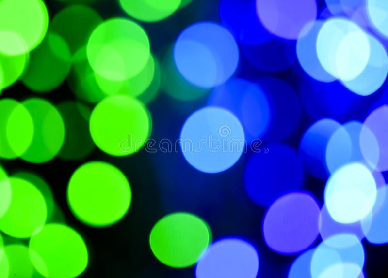 绿色和蓝色defocused光背景 抽象bokeh光 免版税库存图片