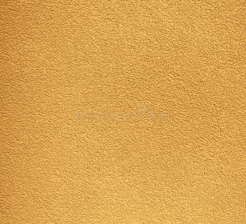 黄色坚固性膏药墙壁、纹理或者背景 免版税库存图片