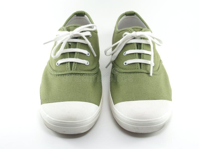 绿色帆布鞋 库存图片