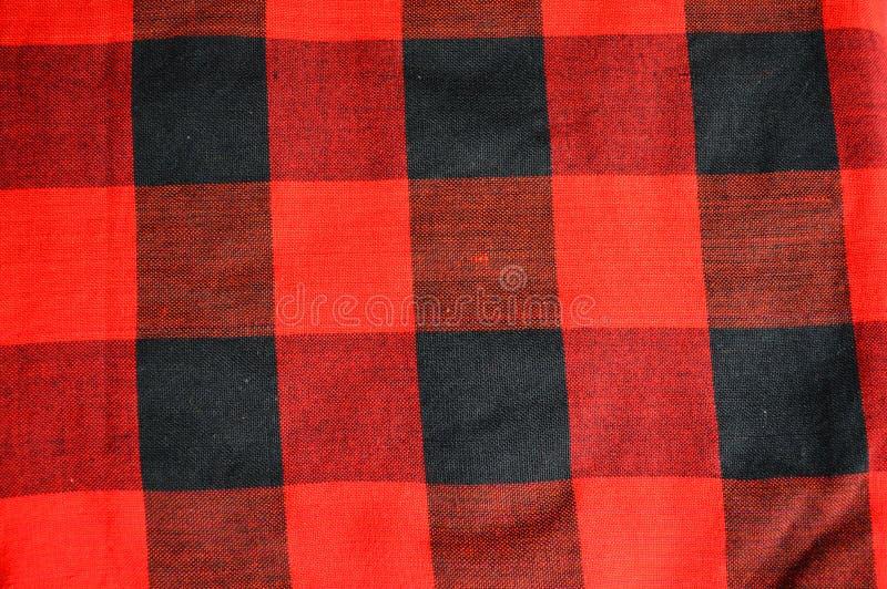 黑色方格的织品红色纹理 库存图片