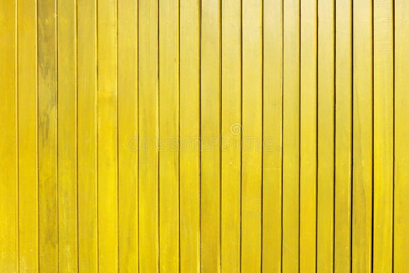 黄色木板条墙壁纹理背景 库存图片