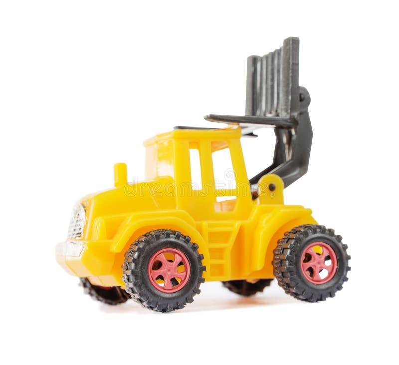 黄色玩具铲车 免版税库存照片