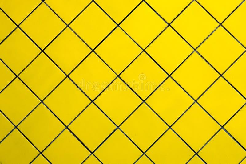 黄色瓦片墙壁 免版税图库摄影