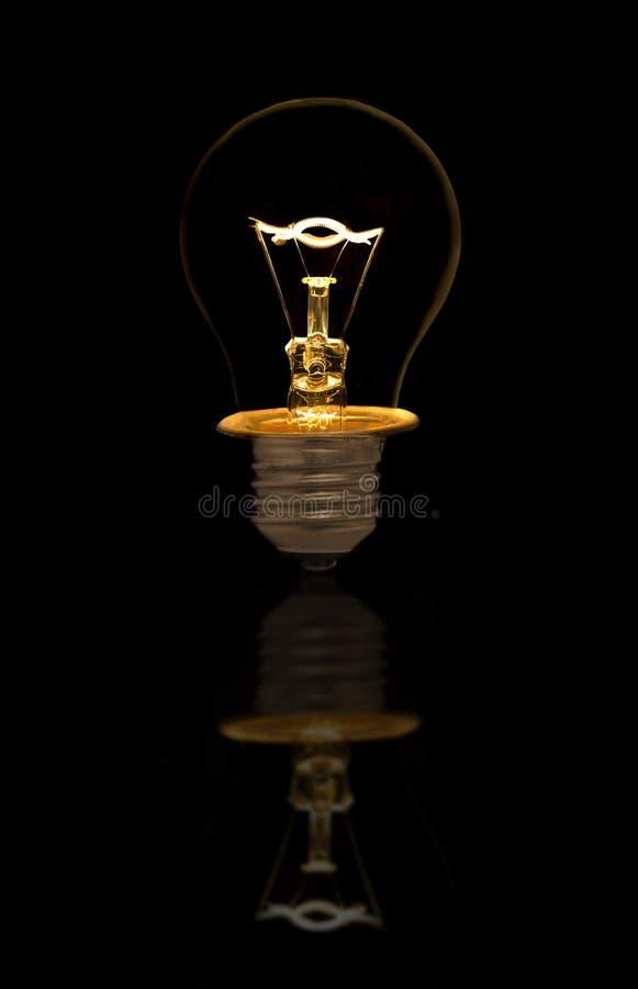 黑色电灯泡白炽光 免版税库存图片