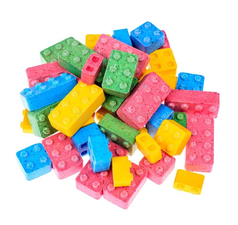 色的嚼的甜点以儿童` s设计师的形式 库存图片