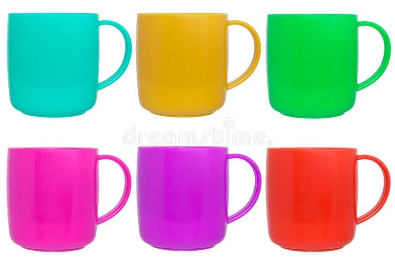 色的塑料儿童杯子收藏 库存图片
