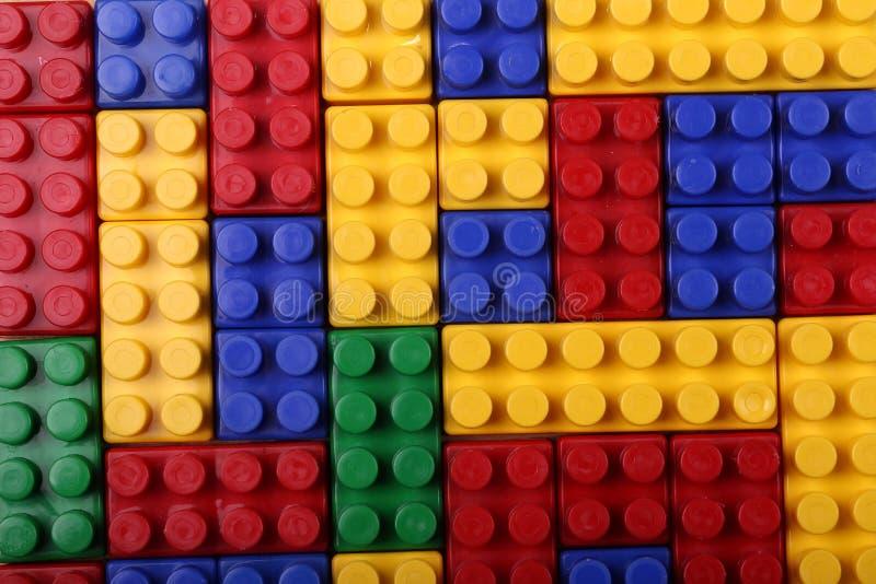 色的塑料砖优质无缝的背景  免版税库存照片