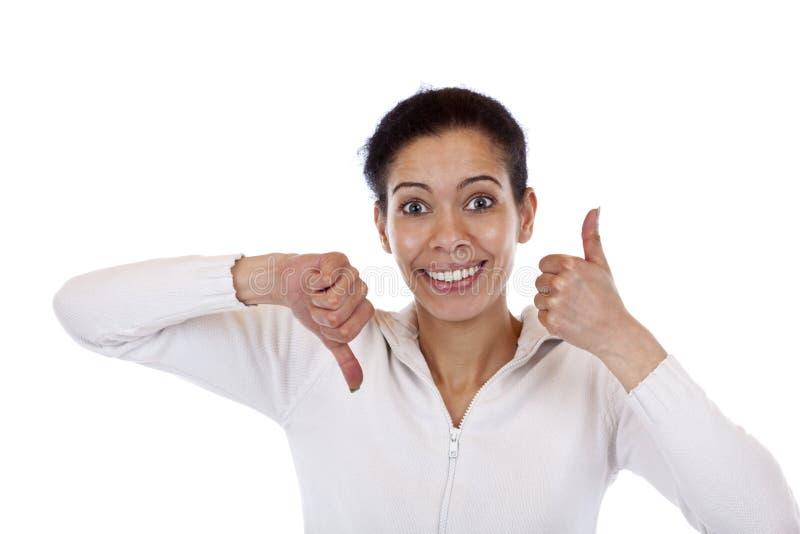 色的妇女显示赞许和下来 免版税库存照片