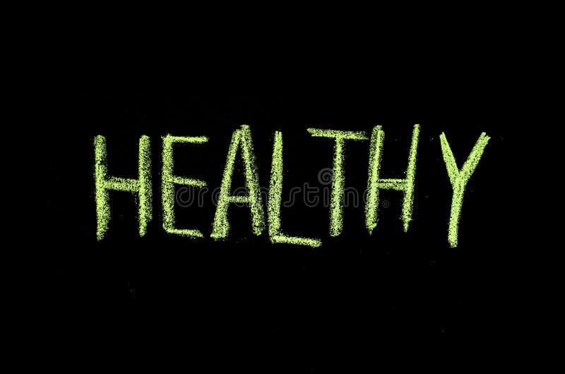 色的文本'在黑板'写的健康 库存照片