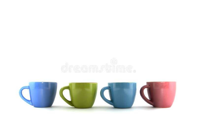 色的杯子 库存图片