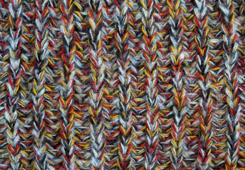 色的毛线被编织的毛织物品  免版税库存照片