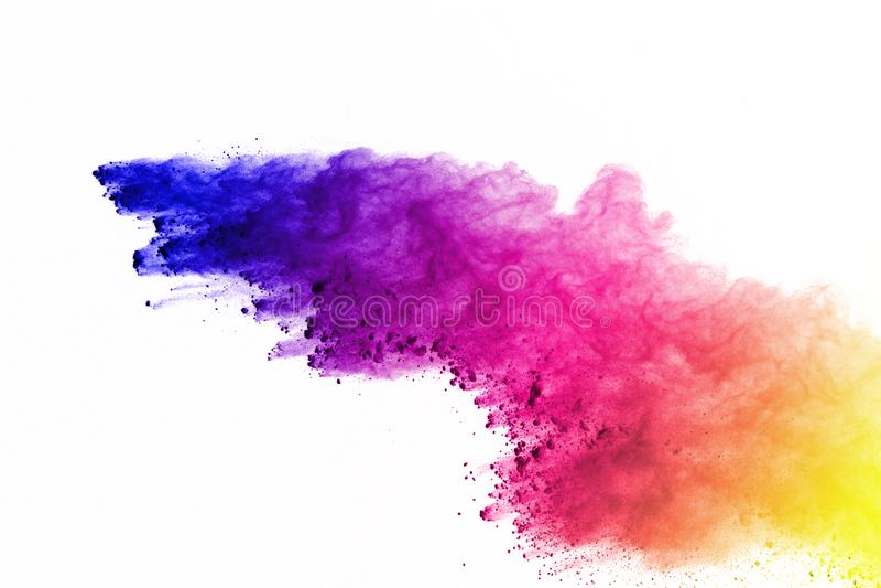 色的粉末爆炸,隔绝在白色背景 splatted的色的尘土摘要  颜色云彩 库存照片