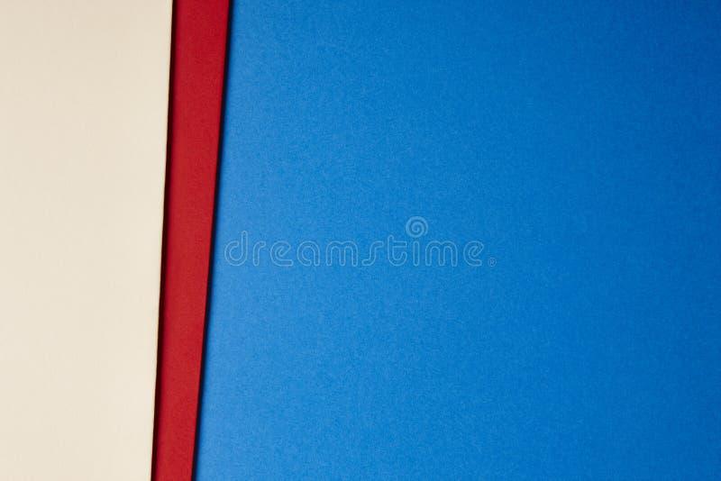 色的纸板背景米黄红色蓝色口气 复制空间 库存照片