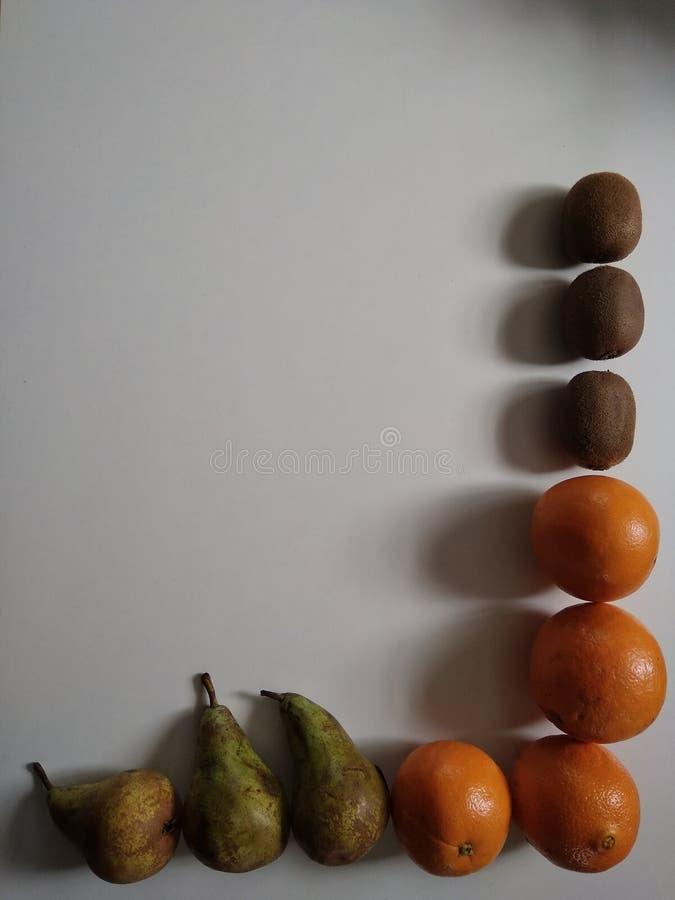 色的背景用果子 库存图片