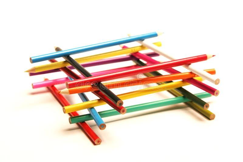 色的eachother铅笔被堆积的顶层 库存照片