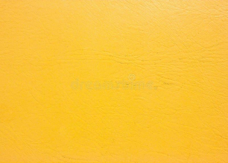 黄色皮革背景 免版税库存照片