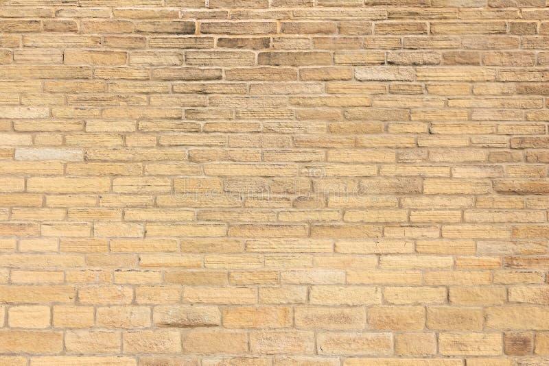 黄色砖墙 免版税库存照片