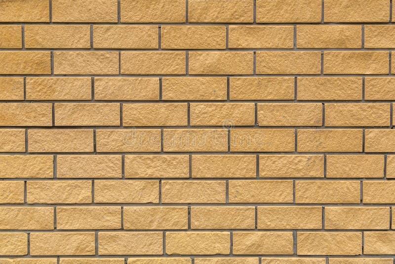 黄色砖背景  免版税库存照片