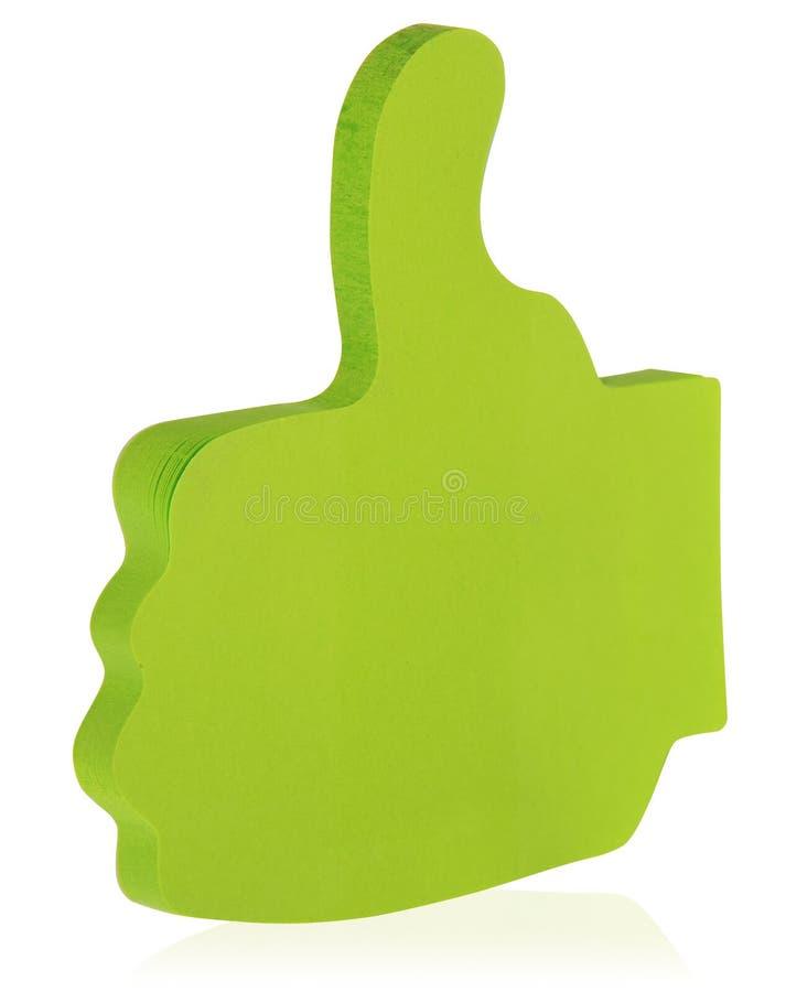 绿色稠粘的笔记黏附了以一个被举的拇指的形式,象  免版税库存图片