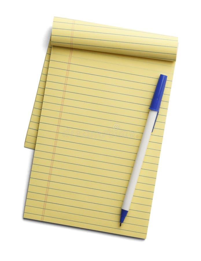黄色笔记本和笔 免版税库存照片