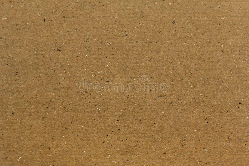 黄色纸盒纸纹理或背景 免版税库存照片