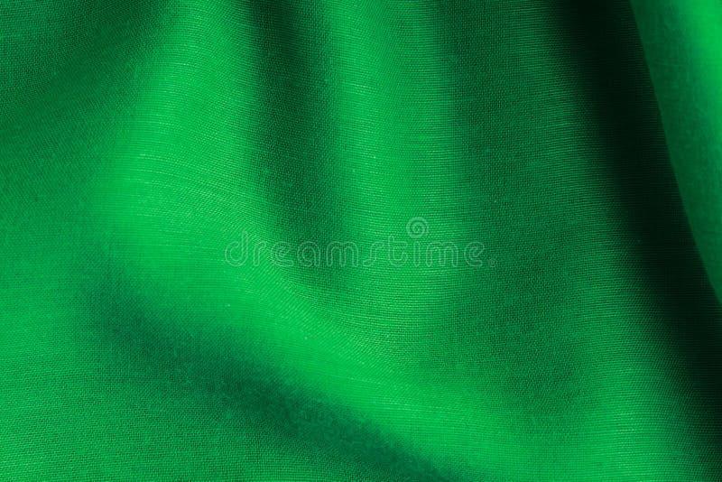 绿色纺织品纹理背景摘要布料波浪折叠  库存照片