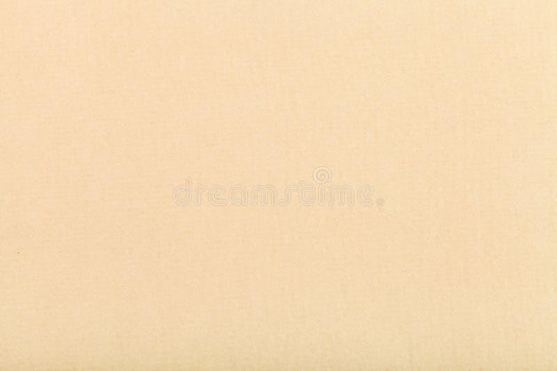 从黄色色的织地不很细纸的背景 免版税库存图片