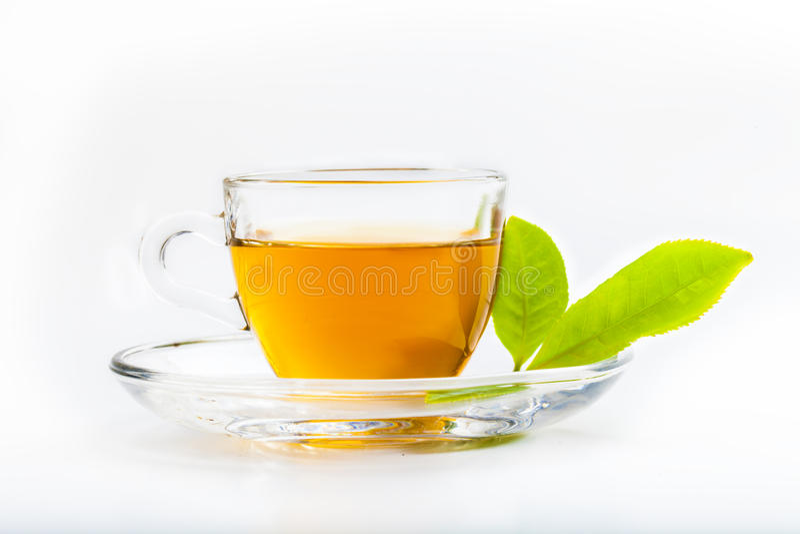 绿色茶叶和玻璃杯子红茶 免版税库存照片