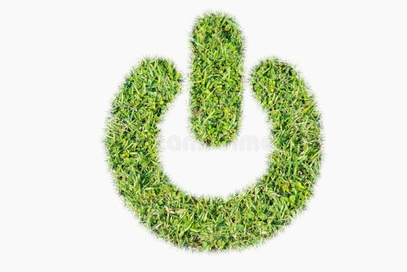 绿色草皮商标电源开关  免版税库存照片