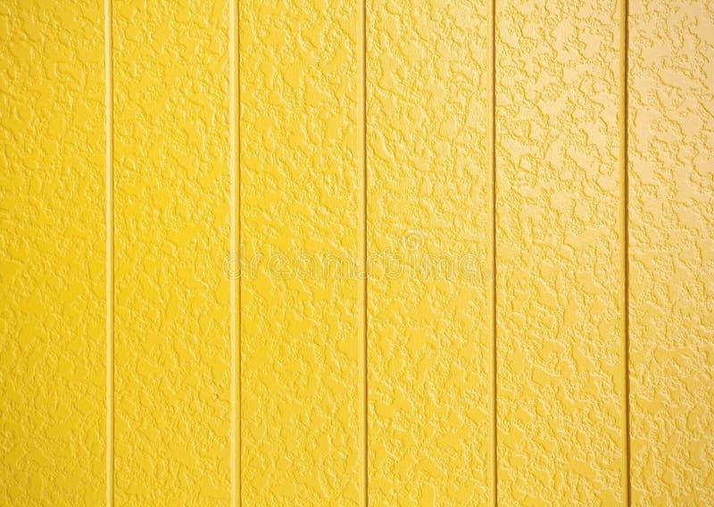 黄色被绘的墙壁 免版税库存照片