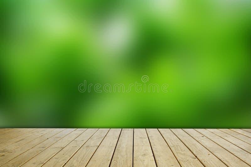 绿色迷离墙壁背景和棕色木地板 库存照片