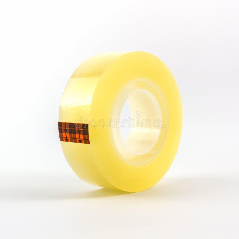 黄色透明胶带卷 免版税库存图片