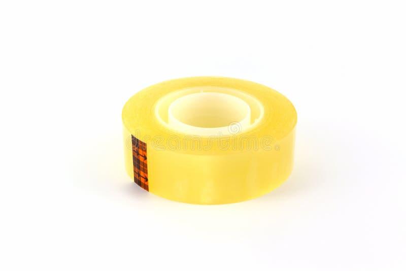 黄色透明胶带卷 库存图片