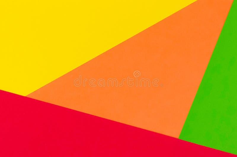 黄色,红色,绿色和橙色颜色纸背景 库存图片