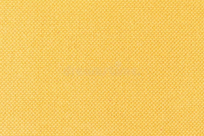 黄色织品背景,材料的纹理,关闭 免版税库存照片
