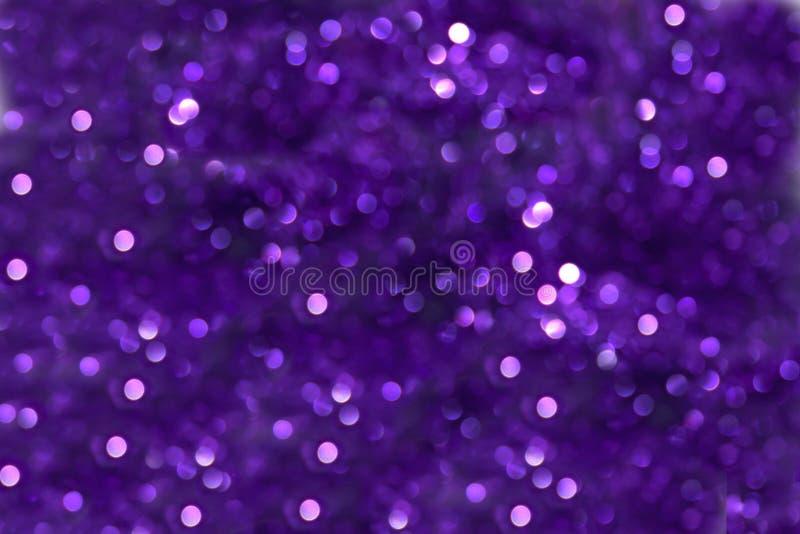紫色bokeh作用 免版税库存图片