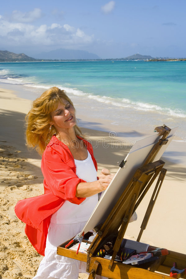 艺术家海滩女性绘画 图库摄影