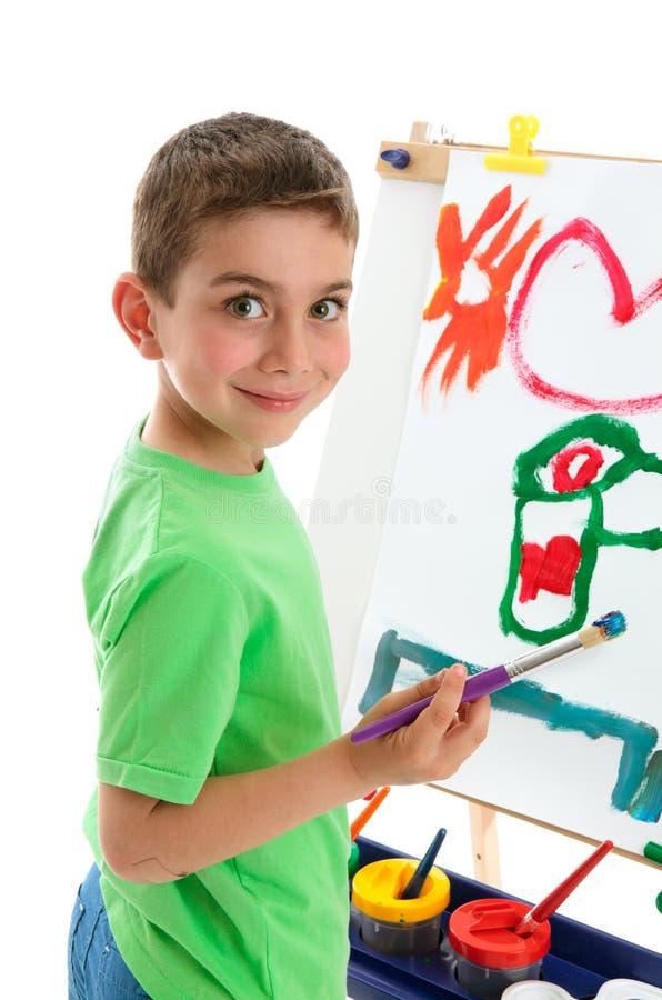 艺术家男孩画架绘画年轻人 免版税库存照片