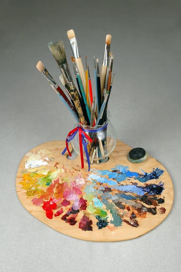 艺术家画笔调色板 库存照片