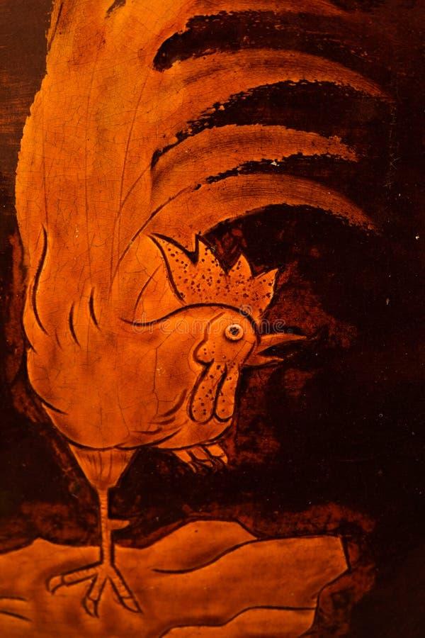 艺术的公鸡样式在瓶子的 免版税库存图片