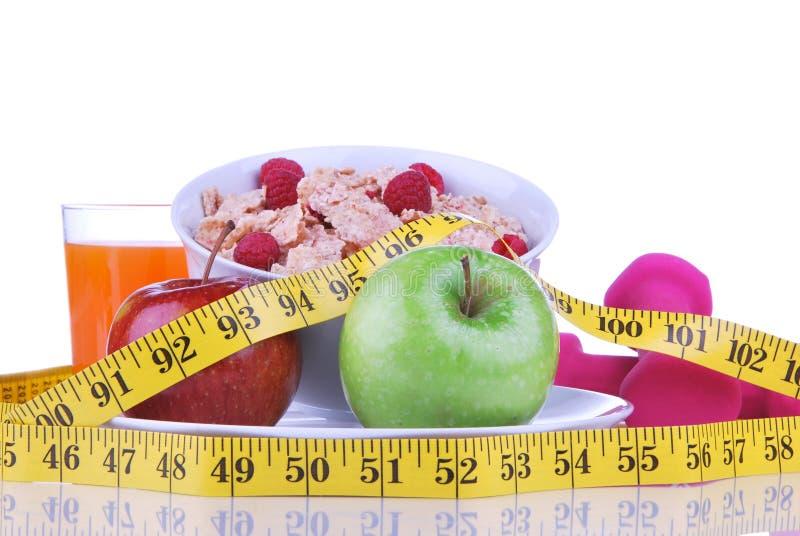 节食与卷尺红色的减重概念 库存图片
