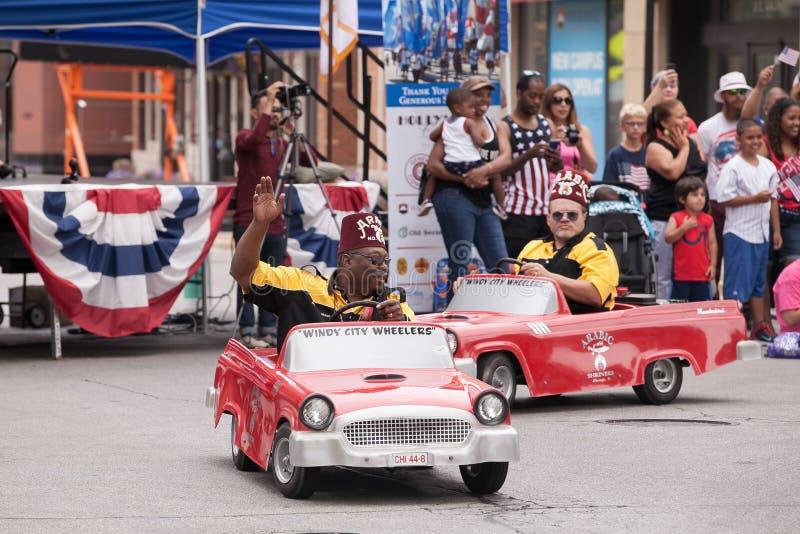 芝加哥`有风城市轮车`美国独立纪念日游行Shriners  图库摄影